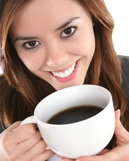 Lady enjoying a cup of coffee