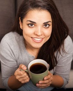 Young lady enjoying a cup of coffee